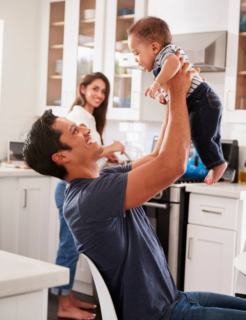 Father And Mother In Kitchen With Child